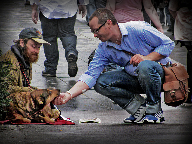 Homeless man on street with dog