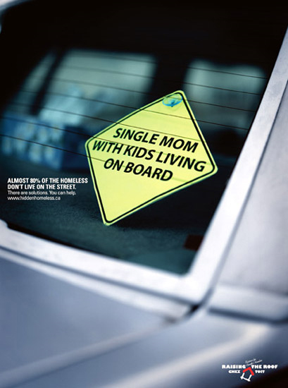 """Single mom with kids living on board"" sticker on a car. Raising the Roof image."